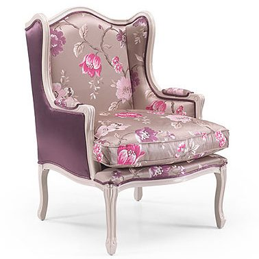 Wingbacked armchair with a pink floral fabric