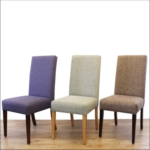 Three dining chairs in different colours