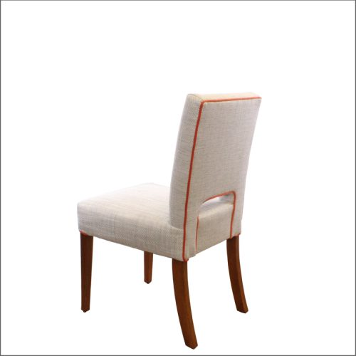 Cream chair with orange piping