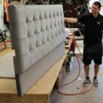 The manufacture of a grey buttoned headboard
