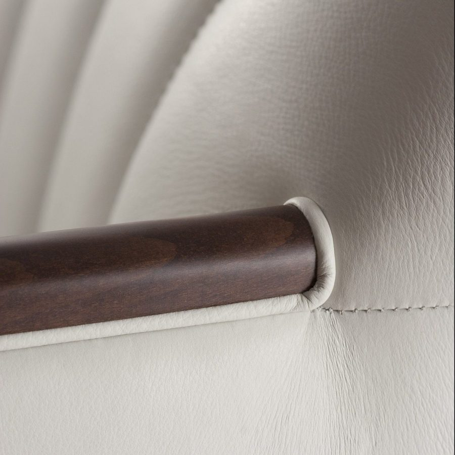 Close up of fluted stitching on white chair